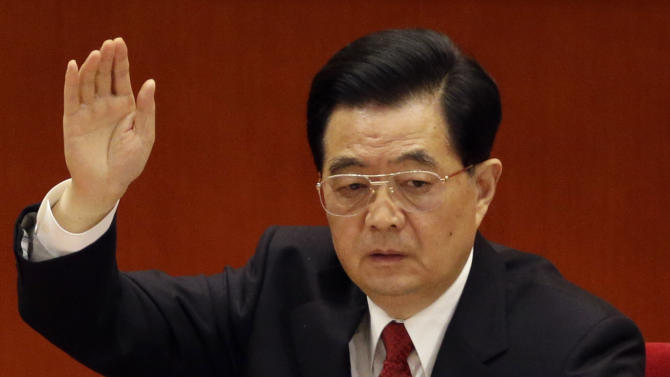 Chinese President Hu Jintao raises his hand to show approval for a work report during the closing ceremony for the 18th Communist Party Congress held at the Great Hall of the People in Beijing, China, Wednesday Nov. 14, 2012. (AP Photo/Lee Jin-man)
