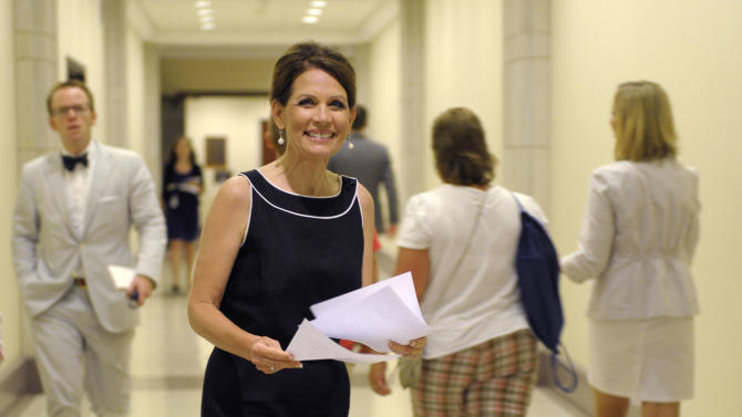 Republican presidential candidate, Rep. Michele Bachmann, R-Minn. heads to a news conference on Capitol Hill in Washington, Wednesday, July 13, 2011. (AP Photo/Susan Walsh)