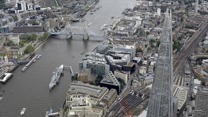 FILE - A general view of London from the air showing the newly built and opened Shard tower, right, in central London in this Friday, July, 13, 2012 file photo. Britain's tallest building, the 2012 Olympic cauldron and a non-stick ketchup bottle are among contenders for a major design award. London's Design Museum on Monday  Jan 14 2013 announced nominees for its Designs of the Year prizes in seven categories including architecture, fashion, transport and digital media. (AP Photo/Alastair Grant, File )
