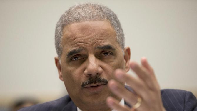 Attorney General Eric Holder testifies on Capitol Hill in Washington, Wednesday, May 15, 2013, before the House Judiciary Committee oversight hearing on the Justice Department. Holder is expected to face aggressive questioning on topics ranging from the Justice Department's gathering of phone records at the Associated Press to the government's handling of intelligence before the Boston Marathon bombings. (AP Photo/Carolyn Kaster)