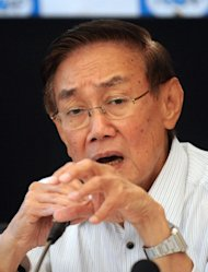 The chief negotiator for the Philippines' communist insurgents, Luis Jalandoni, gestures during a forum in Manila on September 3, 2011. Jalandoni said such programmes would include agrarian reform, rural development and industrialisation