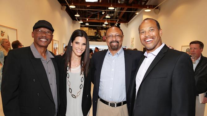 EXCLUSIVE CONTENT - PREMIUM RATES APPLY Former Dogers player Darrell Thomas, Sandra Bullock, Former Dodgers player Kenny Landreaux and Major League Baseball Scouting Bureau's Darrell Miller  at Artist Pat Riot's Art Exhibit, 'Out of Left Field' benefiting the MLB Urban Youth Academy on Thusday, May, 23rd, 2013 in Los Angeles. (Photo by Eric Charbonneau/Invision for Protagonist Brand Management/AP Images)