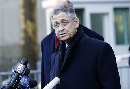 New York Assembly Speaker Sheldon Silver speaks at microphones as he leaves the federal court in New York