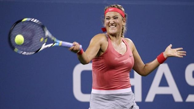 Victoria Azarenka of Belarus returns a volley to Dinah Pfizenmaier of Germany at the US Open (Reuters)