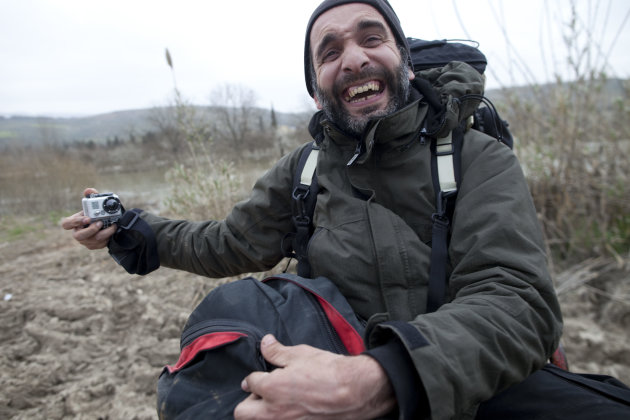 FILE - In this Monday, March 12, 2012 file photo, AP's Ahmed Bahaddou laughs while on assignment in southern Turkey. Bahaddou, a Belgian citizen, was struck in the shoulder by a bullet during a firefight Friday and was evacuated Sunday, June 17, 2012, to London. He was admitted to a hospital in stable condition, and the wound was not considered life threatening. Bahaddou's injury highlights the dangers to reporters seeking to cover Syria's uprising, which activists trying to topple the regime of President Bashar Assad say has killed more than 14,000 people. (AP Photo/Rodrigo Abd, File)