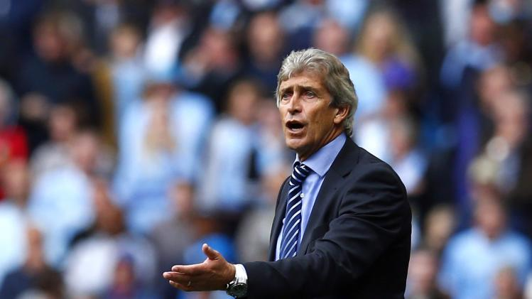 Manchester City manager Pellegrini reacts during their English Premier League soccer match against Stoke City at the Etihad stadium in Manchester