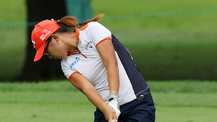 Lydia Ko, of New Zealand, hits from the fairway on the 16th hole during second round play at the Canadian Pacific Women's Open golf tournament in London, Ontario, Friday, Aug. 22, 2014. (AP Photo/The Canadian Press, Dave Chidley)