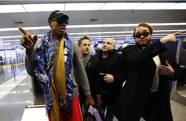 Former NBA basketball player Dennis Rodman gestures as he leaves for Pyongyang from Beijing International Airport