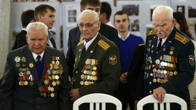 World War II veterans come to meet President Vladimir Putin taking part in ceremonies marking the 70th anniversary of the Battle of Stalingrad in the southern Russian city of Volgograd, once known as Stalingrad, Saturday, Feb. 2, 2013. Russia celebrates the 70th anniversary of  the end of one of modern warfare's bloodiest battles that was turning point in World War II and led to the defeat of the Nazi Germany.  (AP Photo/Alexander Zemlianichenko, Pool)