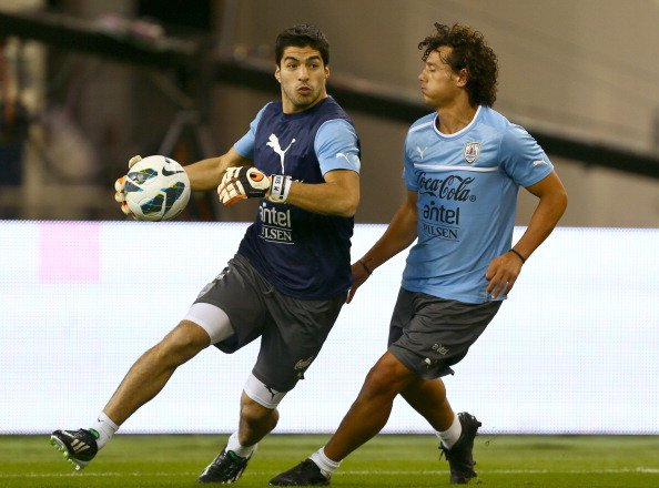 Pictures: Liverpool striker Luis Suarez plays in goal during Uruguay training