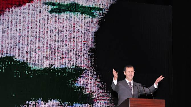 In this photo released by the Syrian official news agency SANA, Syrian President Bashar Assad speaks at the Opera House in central Damascus, Syria, Sunday, Jan. 6, 2013. Syrian President Bashar Assad on Sunday outlined a new peace initiative that includes a national reconciliation conference and a new government and constitution but demanded regional and Western countries stop funding and arming rebels first.(AP Photo/SANA)