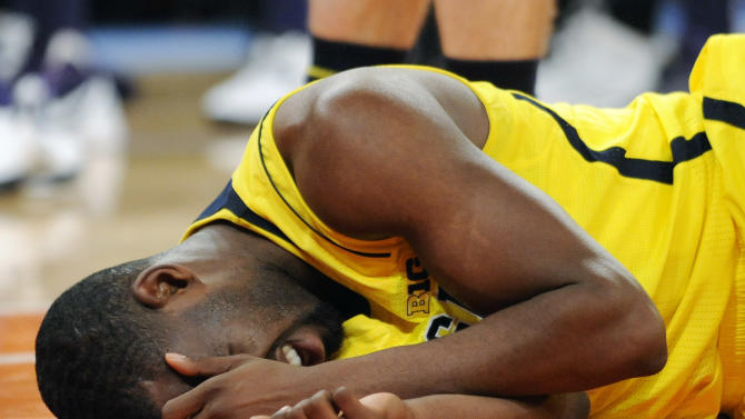 Michigan's Tim Hardaway Jr. lies on the court after being injured during the second half of an NCAA college basketball  game against Kansas State in the championship of the NIT Season Tip-Off at Madison Square Garden in New York, Friday, Nov. 23, 2012. Michigan won 71-57. (AP Photo/Bill Kostroun)