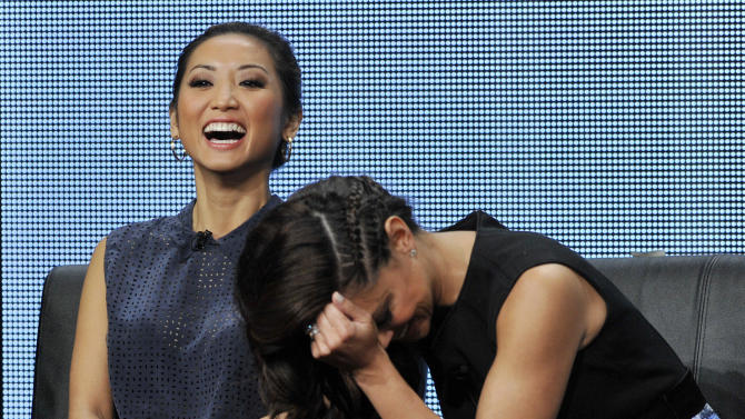 """Brenda Song, left, and Vanessa Lachey, cast members in the FOX series """"dads,"""" laugh during a panel discussion on the show at the FOX 2013 Summer TCA press tour at the Beverly Hilton Hotel on Thursday, Aug. 1, 2013 in Beverly Hills, Calif. (Photo by Chris Pizzello/Invision/AP)"""