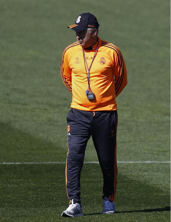 Real's head coach Carlo Ancelotti walks along the field during a training session in Madrid, Spain, Monday March 17, 2014, ahead of their Champions League round of 16, second leg, soccer match bet