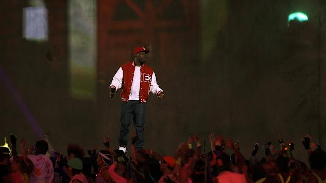 Dizzee Rascal performs during the Opening Ceremony at the 2012 Summer Olympics, Friday, July 27, 2012, in London. (AP Photo/David Goldman)