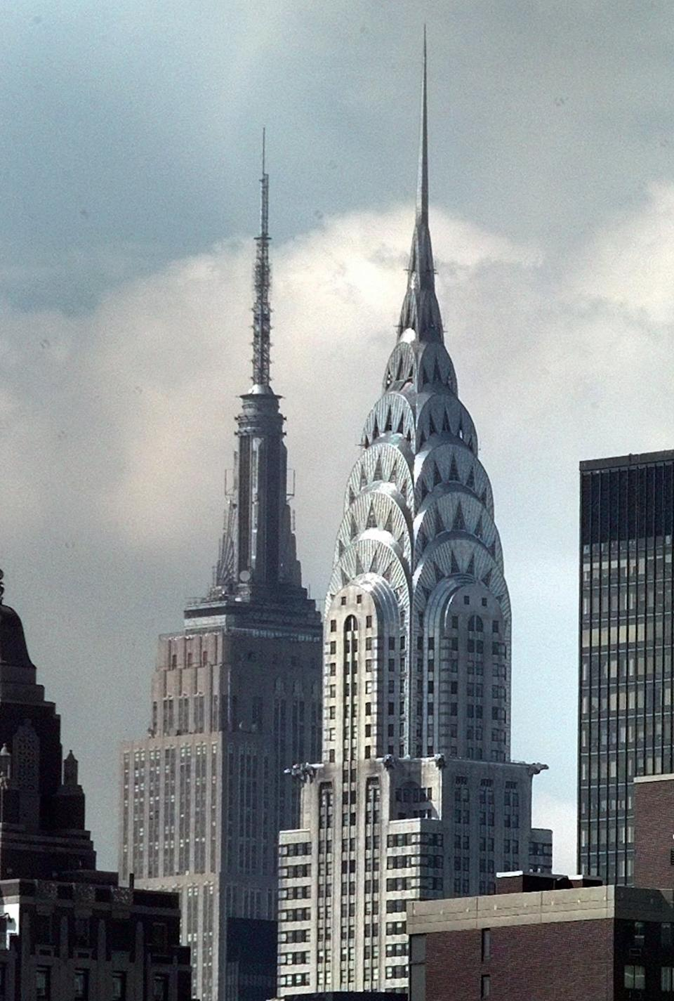 FILE - This Sept. 15, 1997, file photo, shows the Chrysler Building, right center, and The Empire State Building, left center, in New York. The Chrysler Building was New York's tallest from 1930-31, until the completion of the Empire State Building. (AP Photo/Richard Drew, File)