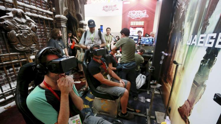 "Attendees wearing Oculus Rift virtual reality headsets view a 3D video for ""Pacific Rim: Jaeger Pilot"" during the 2014 Comic-Con International Convention in San Diego"