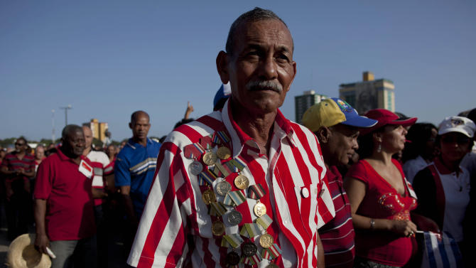 A veteran of the Revolution wearing his military medals walks to an event marking Revolution Day in Guantanamo, Cuba, Thursday, July 26, 2012. Cuba marks the 59th anniversary of the July 26, 1953 rebel attack led by Fidel and Raul Castro on the Moncada military barracks. The attack is considered the beginning of the revolution that culminated with dictator Fulgencio Batista's ouster. (AP Photo/Ramon Espinosa)