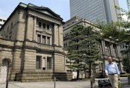 The Bank of Japan headquarters in Tokyo. The central bank has followed its US and European counterparts in announcing extra bond buying to take its total monetary easing effort past $1 trillion as it seeks to revitalise the economy