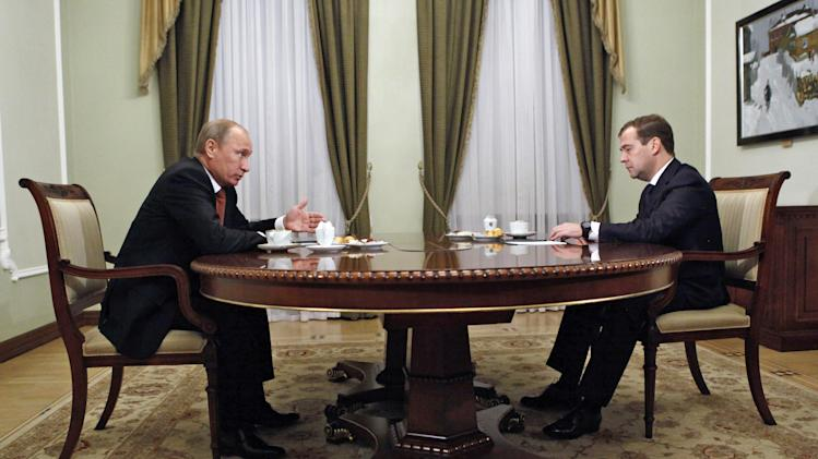Russian President Vladimir Putin, left, and Russian Prime Minister Dmitry Medvedev, during their meeting at the Novo-Ogaryovo residence outside Moscow, Thursday, Sept. 27, 2012. A year ago, Dmitry Medvedev showed an unswerving loyalty to his mentor Vladimir Putin when he refused to seek a second presidential term and agreed to swap jobs. But Medvedev's self-denial hasn't prevented Putin from systematically rolling back indecisive and half-hearted attempts at liberal reforms made by his pliant placeholder during four years in the Kremlin. That campaign has seen the revision of Medvedev's laws, the reversal of some of his key policies and even rolling back his initiative to move the clock.   (AP Photo/RIA-Novosti, Dmitry Astakhov, Government Press Service)