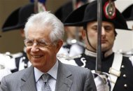 Italy's Prime Minister Monti looks on before a meeting with Switzerland's President Widmer-Schlumpf in Rome