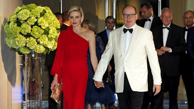 Prince Albert II of Monaco and his wife Princess Charlene arrive at the Red Cross Gala in Monte Carlo