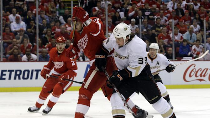 Anaheim Ducks left wing Matt Beleskey (39) and Detroit Red Wings defenseman Kyle Quincey (27) collide in the first period of Game 4 of a first-round NHL hockey Stanley Cup playoff series in Detroit, Monday, May 6, 2013. (AP Photo/Paul Sancya)