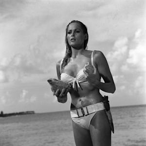 "This undated publicity photo provided by United Artists and Danjaq, LLC shows Ursula Andress in a scene from the James Bond film, ""Dr. No."" Her image personifies the gorgeous, mysterious cool of the Bond girl. The film is included in the MGM and 20th Century Fox Home Entertainment Blu-Ray ""Bond 50"" anniversary set. (AP Photo/United Artists and Danjaq, LLC)"