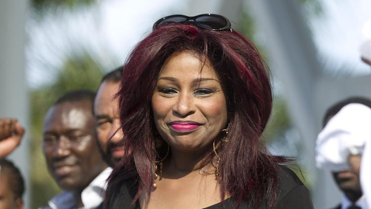 FILE - In a Sunday, April 1, 2012 file photo, singer Chaka Khan joins a rally of support for the family of Trayvon Martin as thousands gather in downtown Miami, demanding justice for Martin. New York's Appollo Theater confirmed Friday, May 18, 2012 that Grammy-award winning singer Khan will perform a tribute to the late Whitney Houston at the Apollo Theater's gala and awards ceremony. Lionel Richie and the late Etta James will be inducted into the theater's hall of fame during the June 4 gala. (AP Photo/J Pat Carter, File)