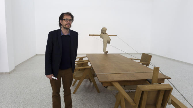 In this photo taken Wednesday, May 29, 2013, artist Mark Manders poses in front of his sculpture 'Mind study', inside the Dutch Pavilion during a preview of the 55th edition of the Venice Biennale of Arts in Venice, northern Italy. (AP Photo/Domenico Stinellis)