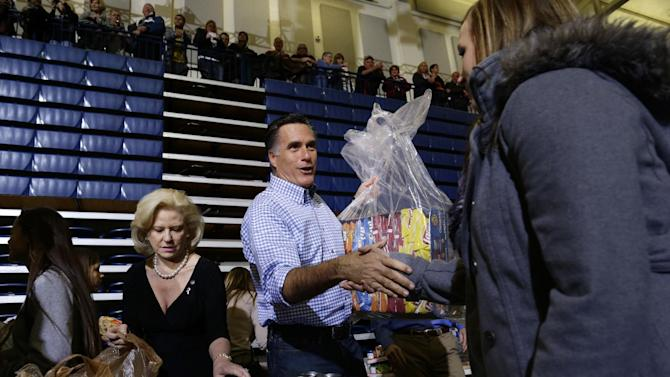 Republican presidential candidate, former Massachusetts Gov. Mitt Romney accepts donations of food as he participates in a campaign event collecting supplies from residents and local relief organizations for victims of superstorm Sandy, Tuesday, Oct. 30, 0212, at the James S. Trent Arena in Kettering, Ohio. (AP Photo/Charles Dharapak)