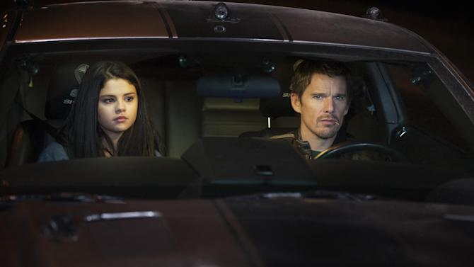 "This film image released by Warner Bros. Pictures shows Selena Gomez, left, and Ethan Hawke in a scene from ""Getaway."" (AP Photo/Warner Bros. Pictures, Simon Varsano)"