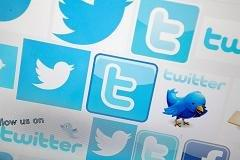 As Twitter IPO prices, poll says it's not worth hype