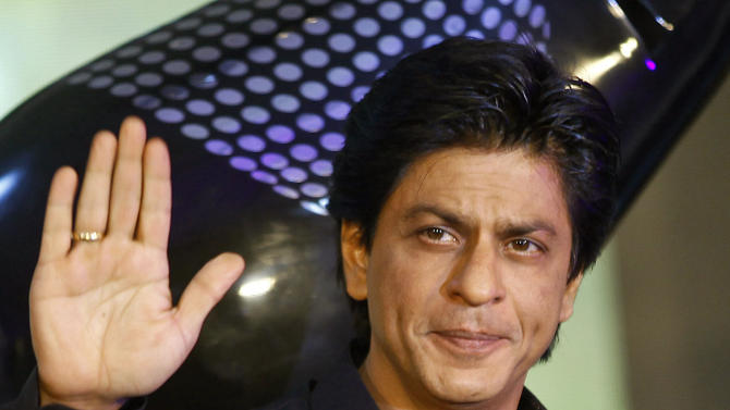 "FILE- In this Jan. 29, 2013 file photo, Bollywood actor Shah Rukh Khan waves during the unveiling of the TOIFA Bollywood awards in Mumbai, India. Bollywood mega-star Shah Rukh Khan has undergone surgery for a shoulder injury suffered while doing stunts for his new movie ""Chennai Express."" Sanjay Desai, his doctor, says Khan's surgery in a Mumbai hospital on Tuesday, May 28, 2013 was successful he will need to rest for two months. (AP Photo/Rafiq Maqbool, File)"