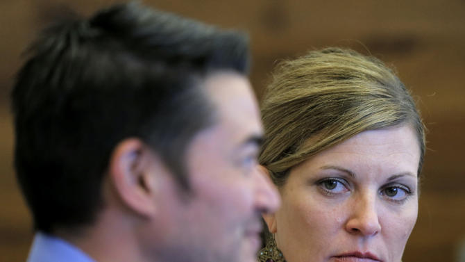 Thomas Beatie, and his girlfriend Amber Nicholas, speak at their attorney's office, Tuesday, April 2, 2013, in Phoenix. Maricopa County Family Court Judge Douglas Gerlach ruled, March 29, 2013,  that Arizona's ban on same-sex marriages prevents Thomas Beatie's 9-year union from being recognized as valid.  Beatie was born a woman and later underwent a double-mastectomy, and began testosterone hormone therapy and psychological treatment to become a man, but he retained female reproductive organs and gave birth to three children. Gerlach said he had no jurisdiction to approve a divorce because there's insufficient evidence that Beatie was a man when he married Nancy Beatie in Hawaii. (AP Photo/Matt York)