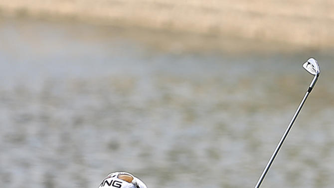 Louis Oosthuizen of South Africa hits the ball on the ninth hole during the fourth round of the Singapore Open golf tournament at the Serapong Course at Sentosa Golf Club in Singapore on Sunday Nov. 11, 2012. (AP Photo/Wong Maye-E)