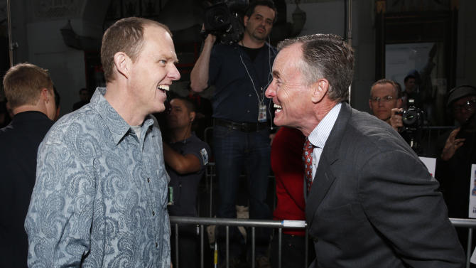 """Director and screenplay writer Brian Helgeland and John C. McGinley  arrive at the LA premiere of """"42"""" at the TCL Chinese Theater on Tuesday, April 9, 2013 in Los Angeles. (Photo by Todd Williamson /Invision/AP)"""