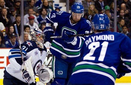 Canucks rally past Jets for 3-2 win