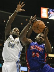 Denver Nuggets forward Kenneth Faried (35) and Detroit Pistons' Jason Maxiell (54) go up for a rebound during the second quarter of an NBA basketball game on Wednesday, March 21, 2012 in Denver. (AP Photo/Barry Gutierrez)
