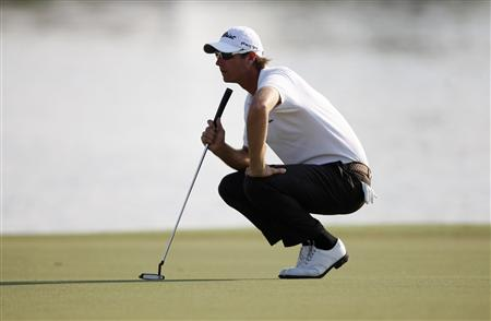 Colsaerts of Belgium lines up his shot on the 18th green during the first round of the DP World Tour Championship at Jumeirah Golf Estates in Dubai