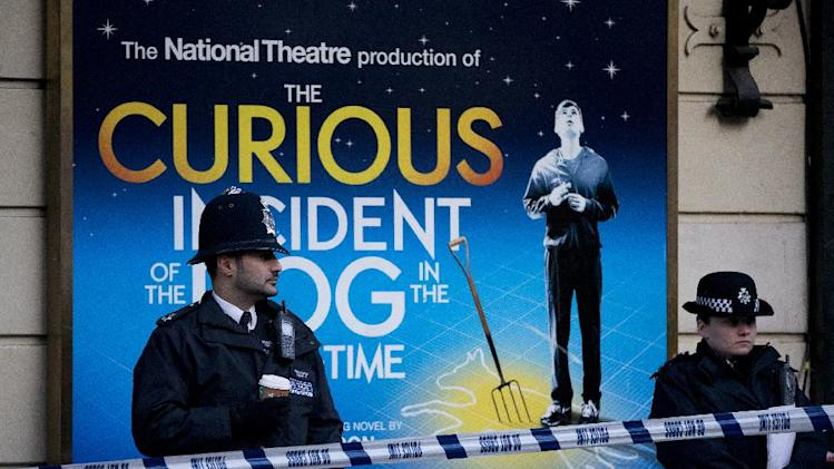 "Police stand outside The Apollo Theatre in London, Friday, Dec. 20, 2013, Authorities are carrying out a structural assessment at the Apollo Theatre after the partial collapse of its ceiling injured more than 75 people in the packed auditorium. An initial report is expected Friday after an overnight survey. The building remains cordoned off after the incident happened during the evening performance of ""The Curious Incident Of The Dog In The Nighttime."" (AP Photo/Alastair Grant)"