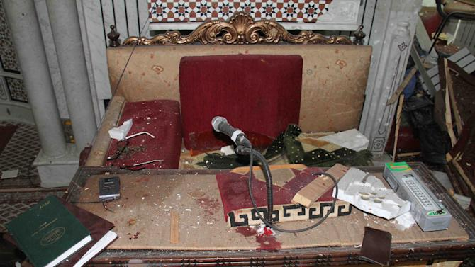 In this photo released by the Syrian official news agency SANA, the desk of Sheikh Mohammad Said Ramadan al-Buti, an 84-year-old cleric known to all Syrians as a religious scholar, is seen after a suicide bomber blew himself up at the Eman Mosque in the Mazraa district, in Damascus, Syria, Thursday, March 21, 2013. A suicide bomber blew himself up during evening prayers inside a mosque in Damascus Thursday, killing a top Sunni Muslim preacher and longtime supporter of President Bashar Assad and least 13 other people, state TV reported. Al-Buti's death is a big blow to Syria's embattled leader, who is fighting mainly Sunni rebels seeking his ouster. (AP Photo/SANA)