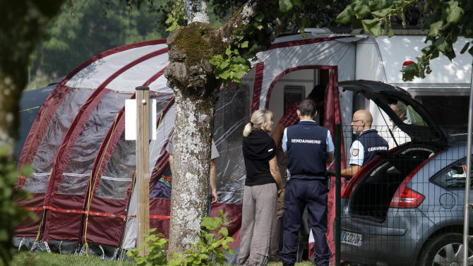 Investigators stand at the camp site where the slain British family were vacationing in Saint Jorioz, near Annecy, Thursday, Sept. 6, 2012. A 4-year-old British girl huddled for eight hours beneath the legs of her slain mother in the back of a car filled with corpses on a remote Alpine road, while French investigators stood nearby, unaware the girl was there.   (AP Photo/Lionel Cironneau)