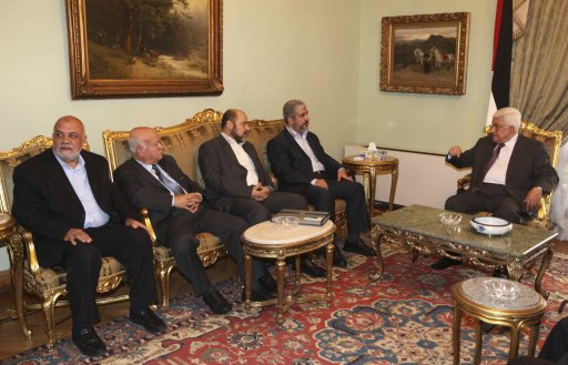 Palestinian President Mahmoud Abbas and Hamas leader Khaled Meshaal talk during their meeting in Cairo