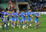 South Korea's Ulsan Hyundai players perform a 'Gangnam Style' dance after winning the AFC Champions League final against Saudi Arabia's Al Ahli in Ulsan last month