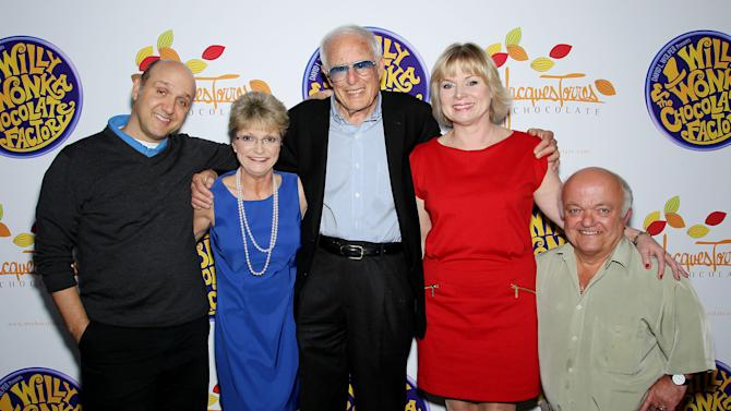 "FILE - This Oct. 18, 2011 file photo originally released by Starpix shows the cast and director from the 1971 film, ""Willy Wonka & The Chocolate Factory,"" from left, Paris Themmen, who portrayed Mike Teevee, Denise Nickerson, who portrayed Violet Beauregarde, director Mel Stuart, Julie Cole, who portrayed Veruca Salt, and  Rusty Goffe, who played the cart-wheeling Oompa-Loompa, posing at Jacques Torres Chocolates during an event promoting the 40th anniversary of the popular children's film and the Warner Home Video Ultimate Collector's Edition Blu-ray and DVD launch in New York. Stuart died Thursday, Aug. 9, 2012 of cancer at his home in Beverly Hills, Calif. He was 83. (AP Photo/StarPix, Marion Curtis, file)"