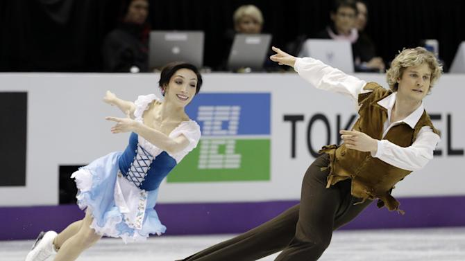 Meryl Davis and Charlie White, of the United States, perform during the ice dance short dance at the World Figure Skating Championships Thursday, March 14, 2013, in London, Ontario. (AP Photo/Darron Cummings)