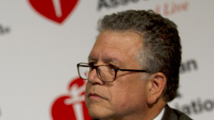 Dr. Gervasio Lamas of Mount Sinai Medical Center in Miami, the leader of a study testing a controversial and experimental treatment for heart disease, speaks at an American Heart Association conference in Los Angeles, Sunday, Nov. 4, 2012. (AP Photo/American Heart Association, Matthew G. Fisher)