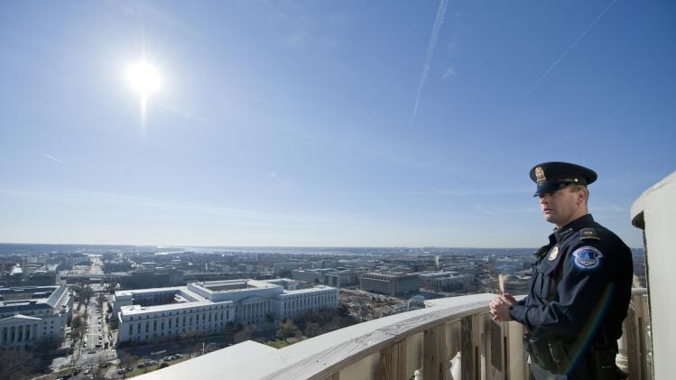 U.S. Capitol police officer looks South from the dome of the U.S. Capitol during a media tour on Capitol Hill in Washington
