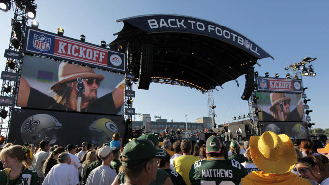 FILE - In this Sept. 8, 2011 file photo, Kid Rock performs during a kickoff concert before an NFL football game between the Green Bay Packers and the New Orleans Saints, in Green Bay, Wis. Football is the most profitable sport in America and the most popular show on TV. Sponsorship revenue is expected to rise 15 percent this year, to total about $9.5 billion, said NFL spokesman Brian McCarthy. (AP Photo/Mike Roemer, File)